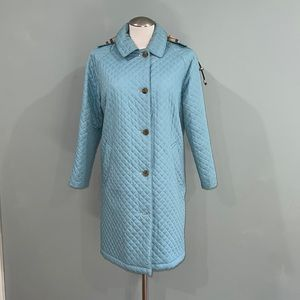 Burberry quilted coat with signature plaid wool liner.